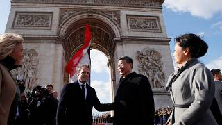 Presidents Xi and Macron leave the Arc de Triomphe in Paris