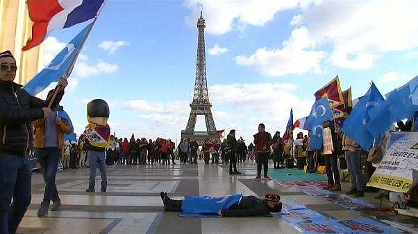 demonstrators gathered on Place du Trocadero square near the Eiffel Tower