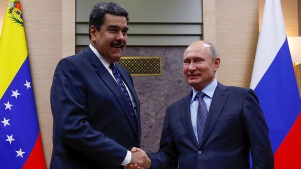 Vladimir Putin y Nicolás Maduro durante una reunión en Moscú, Rusia.