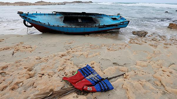 A boat used by migrants is seen near the western town of Sabratha