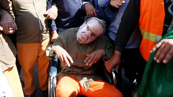 Manifestant avec un masque représentant Abdelaziz Bouteflika, le 29/03/2019