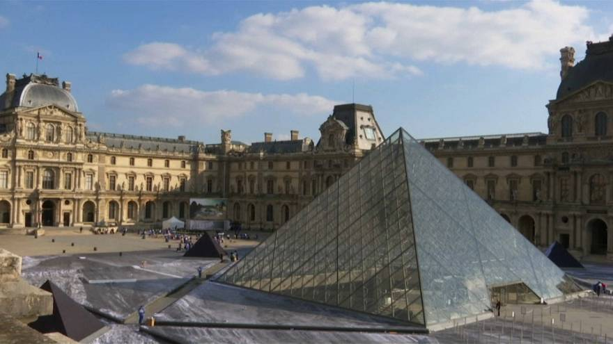 Louvre Pyramid with JR's artwork preparations