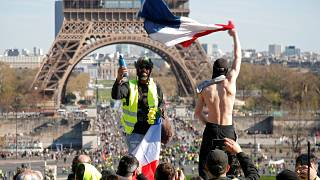 Protesters wearing yellow vests attend a demonstration during the Act XX