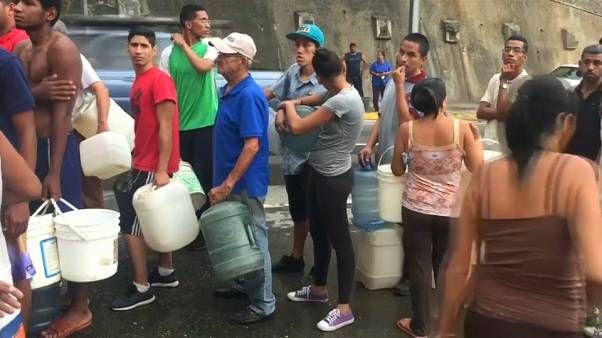 Venezuelans scramble for water as shortages afflict nation