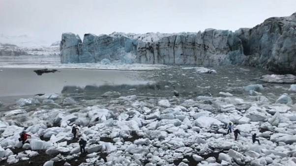 Watch: Tourists flee large wave after Icelandic glacier collapse