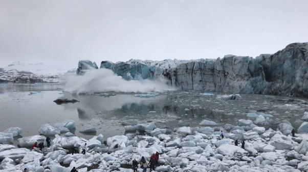 Glacier collapse sends large wave towards shore