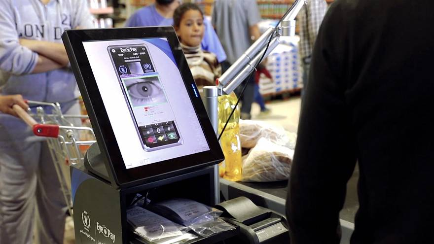 Refugees in Jordan are buying groceries with eye scans