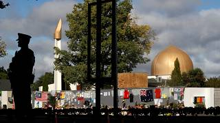 A police officer stands guard outside Al Noor mosque in Christchurch