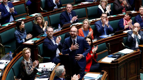 Belgium's Prime Minister Charles Michel reacts after delivering a speech