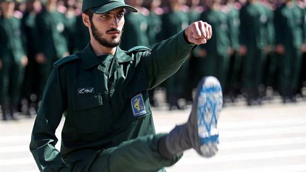 An Iranian IRGC officer with Israel's flag drawn on his boots, June 2018.