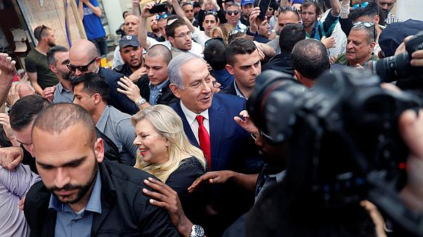 Benjamin Netanyahu and his wife on the campaign trail.