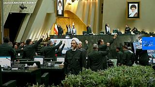 Iranian lawmakers wear Revolutionary Guards uniforms to parliament