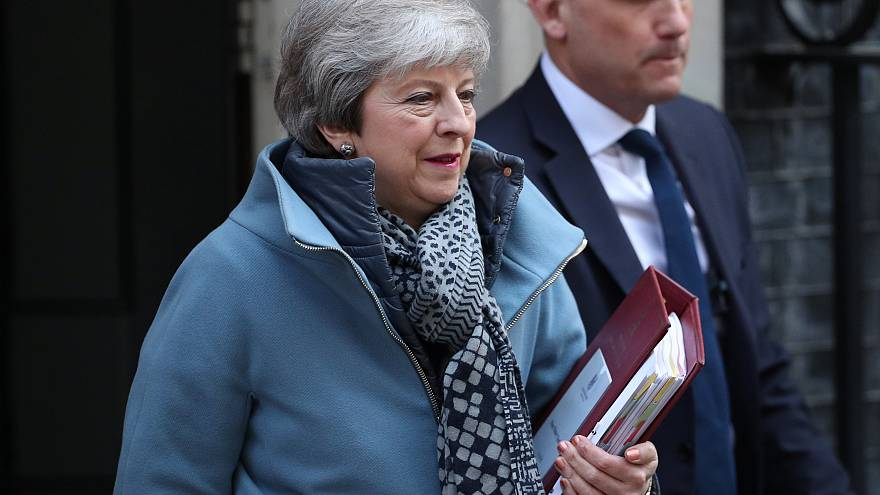 Britain's PM Theresa May leaves Downing Street on April 10, 2019.