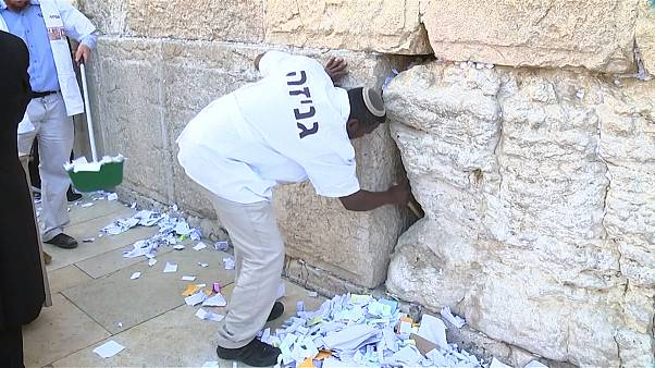 Clean out of written prayers from cracks of Jerusalem's Western Wall