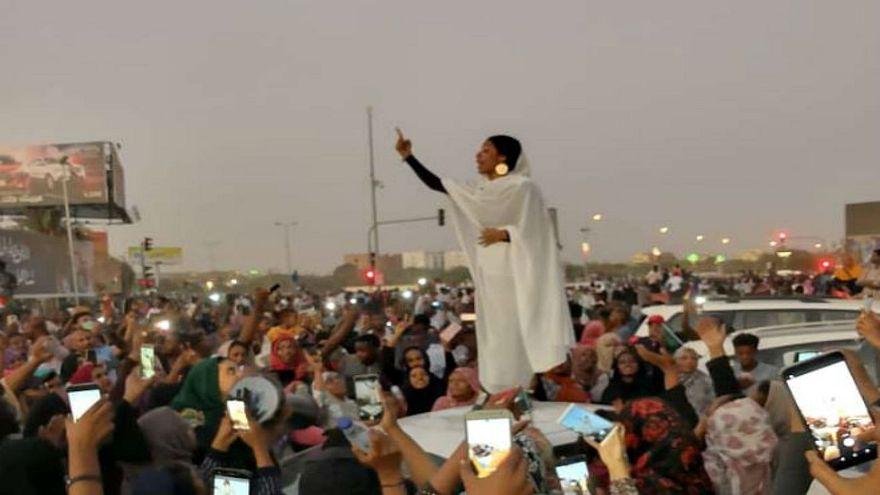 Female protester in Khartoum, 8 April 2019