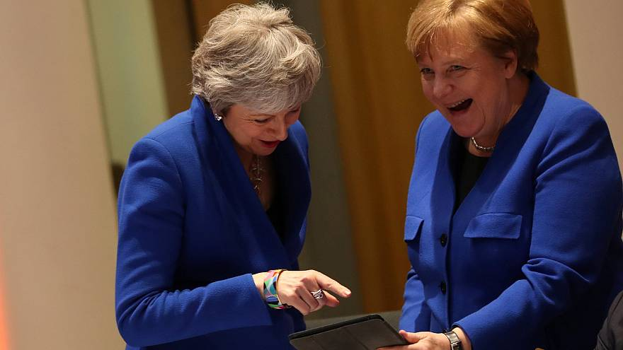 What was on the tablet that had May and Merkel laughing?