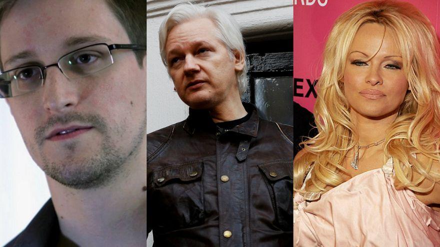 إدوارد سنودن وباميلا أندرسون ينددان باعتقال أسانج