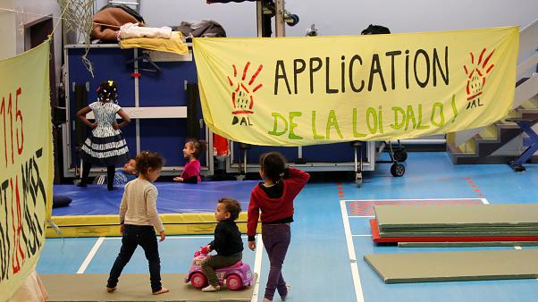 Dozens of homeless families live in the gymnasium Roquepine, Paris
