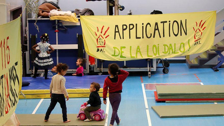 Dozens of homeless families live in the gymnasium Roquepine, Paris