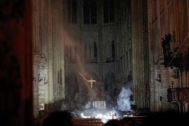 Smoke rises around the altar inside the Notre Dame Cathedral
