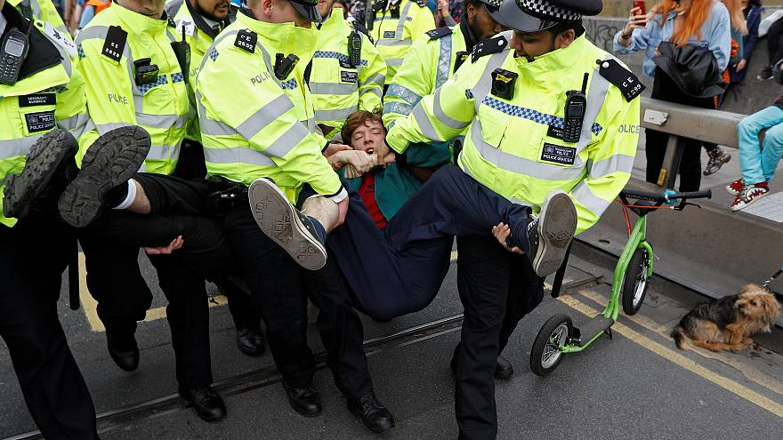Some protesters were carried off by police in London