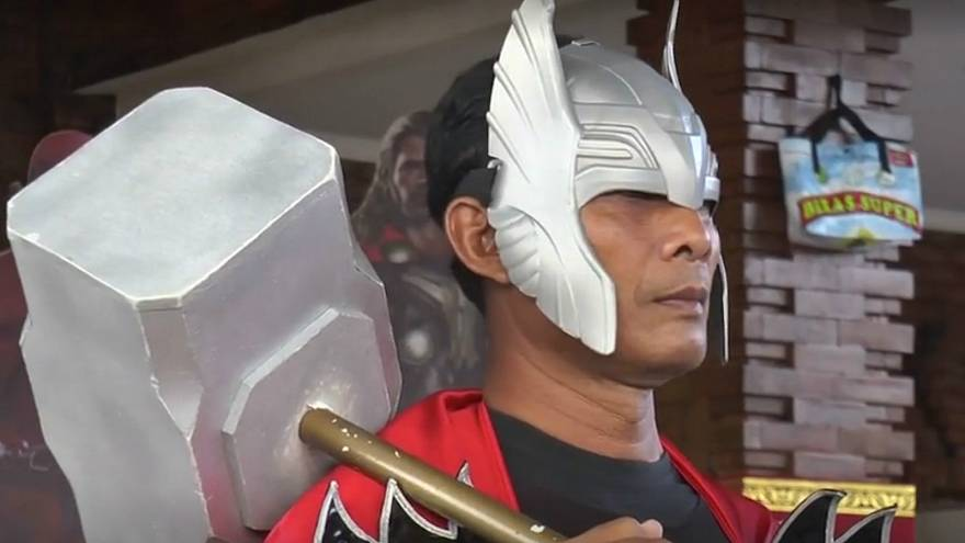 Superheroes step in to help protest Indonesia polling station as voting gets underway
