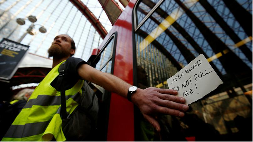 Activist moved away by police at Oxford Circus protest