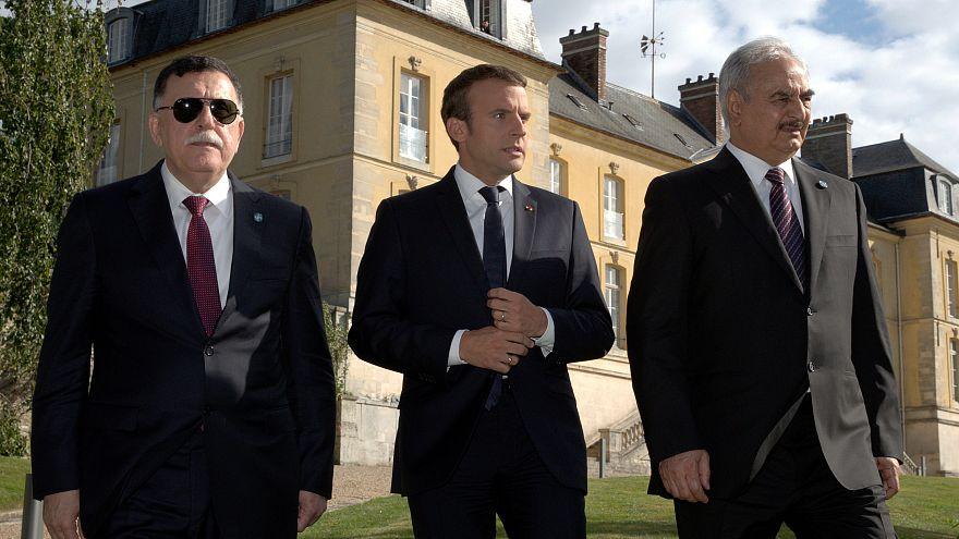 فائز سراج نخست وزیر لیبی به همراه ماکرون رئیس جمهوری فرانسه و خلیفه حفتر