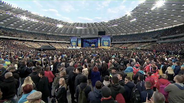 Ukraine election: presidential candidates trade barbs in stadium debate