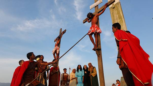 Actors are seen on the cross in a re-enactment of the crucifixion of Jesus