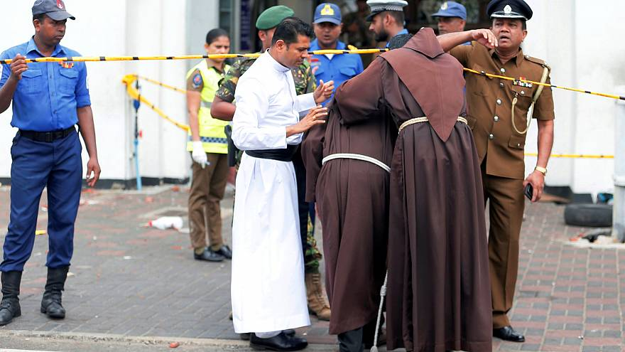 Priests near the entrance to St Anthony's