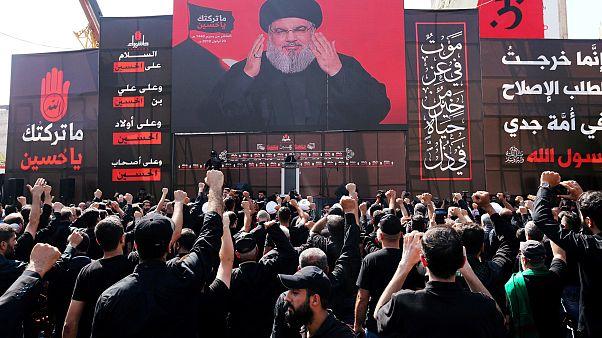 قائد حزب الله اللبناني، السيد حسن نصر الله مخاطباً جمهوره عبر الشاشة
