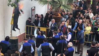 Locals in Spanish town shoot and burn Carles Puigdemont effigy