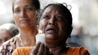 Colombo residents observe a moment of silence