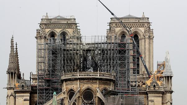 Roof renovation company says workers smoked on top of Notre Dame but rules out that as cause