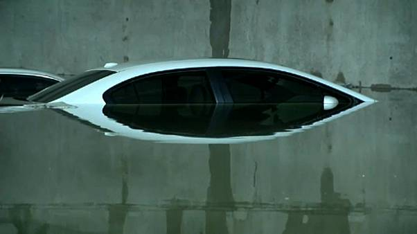 Cars submerged at airport car-park after storms in Dallas