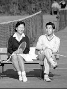 Japan's Crown Prince Akihito talks to Michiko Shoda at tennis match - 1958