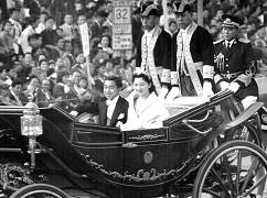 Prince Akihito, Princess Michiko smile during wedding parade - 1959