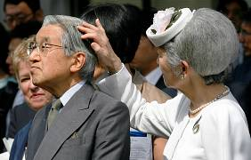 Empress Michiko removes a bee from Emperor Akihito's hair - 2009