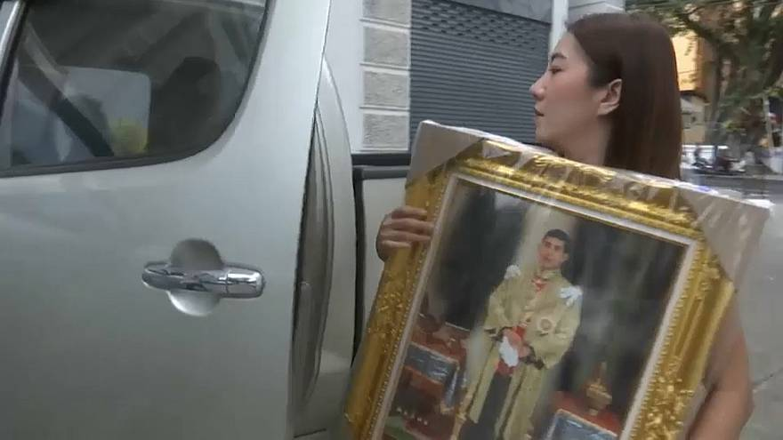 Shoppers are purchasing framed pictures of Thailand's new monarch