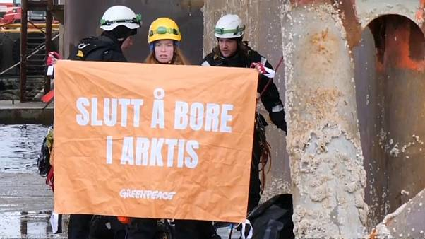 Activists climb aboard rig to protest against new oil and gas drilling in the Norwegian Arctic