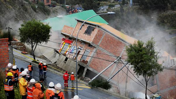 Bolivia: residents watch as landslide sweeps away houses