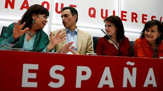 Spain's acting Prime Minister Pedro Sanchez with party members.