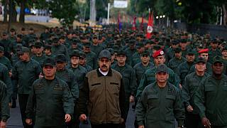 Defiant Maduro tweets pictures of himself with Venezuela's army