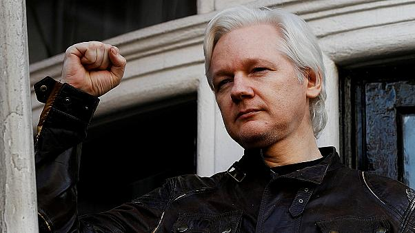 Julian Assange refuses to surrender to US extradition at court hearing in London