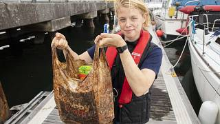Research Fellow Imogen Napper with one of the plastic bags tested