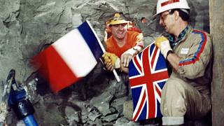 FILE PHOTO: Tunnel workers Philippe Cozette and Graham Fagg, 1990