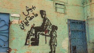 شاهد.. السودان يُوثق ثورته على البشير من خلال لوحة فنية
