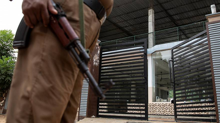 Policeman stands guard outside sealed office of National Tawheed Jamaath