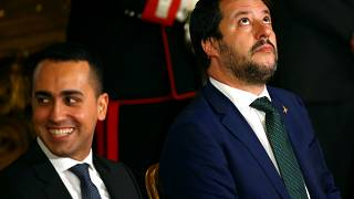 Interior Minister Matteo Salvini looks on next to Italy's Minister of Labor